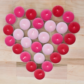 heart of pink and red candles
